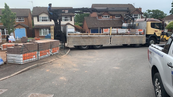 unloading materials for large block paving driveway